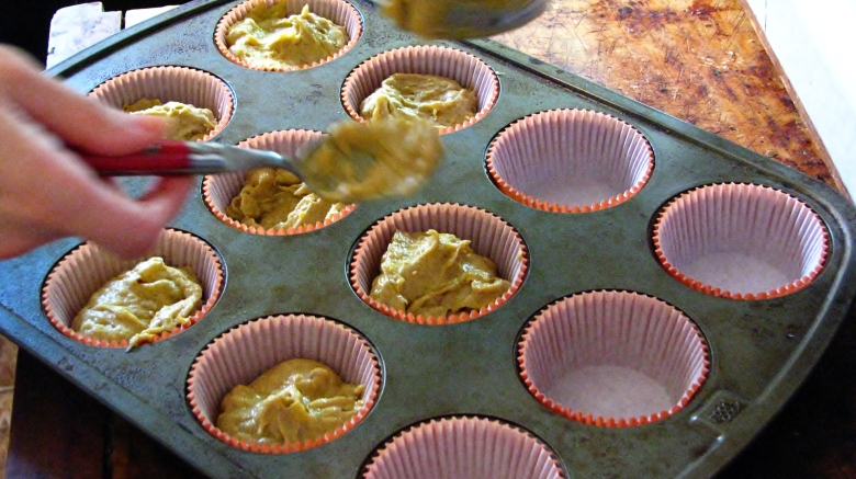 Pumkin Ginger Cupcake liners being filled